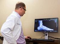 What is a Podiatrist - Dr. Mikkel Jarman Podiatrist in Phoenix AZ - pic viewing Digital imaging x-ray 20 20 system