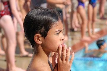 barefoot boy at swim meet